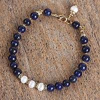 Gold accent lapis lazuli and cultured pearl beaded bracelet, 'Midnight Moonrise' - Gold Accent Cultured Pearl and Lapis Beaded Pendant Bracelet
