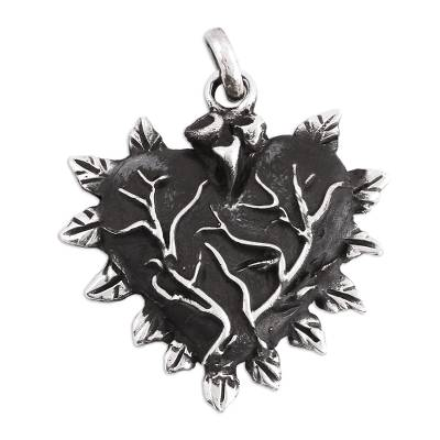 Handcrafted Sterling Silver Flame-Rimmed Heart Pendant