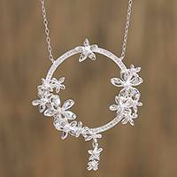 Sterling silver pendant necklace, 'Ring of Flowers' - Circular Floral Sterling Silver Pendant Necklace from Mexico