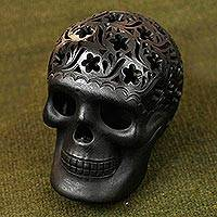 Ceramic figurine, 'Floral Cranium' - Floral Barro Negro Ceramic Skull Figurine from Mexico