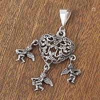 Sterling silver pendant, 'Heart and Spirit' - Floral Heart-Shaped Sterling Silver Pendant from Mexico