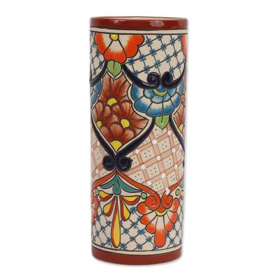 It/'s very unique and pretty. It has butterflies and flowers Hand painted ceramic vase from Mexico leaves