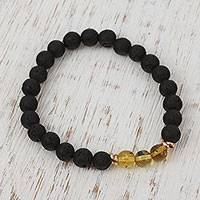 Men's gold accented amber beaded stretch bracelet, 'Ancient Lava' - Men's Gold Accented Amber and Lava Stone Bracelet