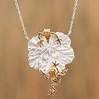 Gold accented sterling silver pendant necklace,