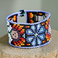 Glass beaded wristband bracelet, 'Huichol World in Blue' - Floral Glass Beaded Wristband Bracelet in Blue from Mexico