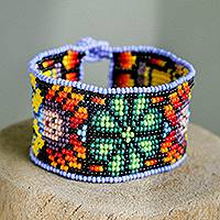 Glass beaded wristband bracelet, 'Huichol World in Green' - Floral Glass Beaded Wristband Bracelet in Green from Mexico