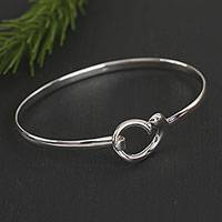 Sterling silver bangle bracelet, 'Delightful Swirl' - Taxco Sterling Silver Bangle Bracelet from Mexico