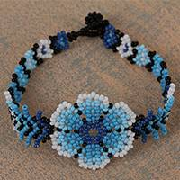 Glass beaded wristband bracelet, 'Huichol Blue' - Floral Glass Beaded Wristband Bracelet from Mexico