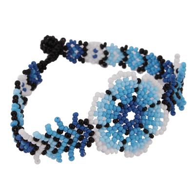 Glass beaded wristband bracelet, 'Huichol Blue' - Floral Glass Beaded Wristband Bracelet from Mexico