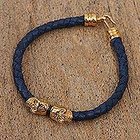Gold accented leather braided pendant bracelet, 'Death in Black' - Gold Accented Leather Braided Skull Pendant Bracelet