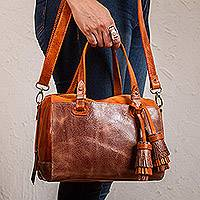 Leather travel bag, 'Tasseled Traveler in Orange' - Handmade Leather Travel Bag in Orange from Mexico