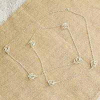 Sterling silver station necklace, 'Knots of Infinity' - Knot Motif Sterling Silver Station Necklace from Mexico