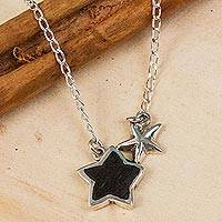 Sterling silver and wood pendant necklace, 'Two Stars' - Star-Shaped Sterling Silver and Wood Pendant Necklace