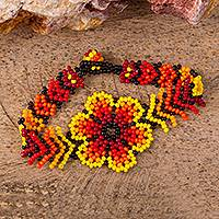 Glass beaded pendant bracelet, 'Flaming Flower' - Fiery Floral Glass Beaded Pendant Bracelet from Mexico