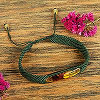 Amber wristband bracelet, 'Age-Old Elegance in Viridian' - Amber Wristband Bracelet with Viridian Cord from Mexico