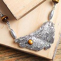 Tiger's eye pendant necklace, 'Solar Winds' - Tiger's Eye and Sterling Silver Necklace from Mexico