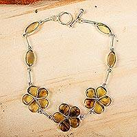 Amber link bracelet, 'Ancient Daisies' - Amber Floral Bracelet with Sterling Silver Links