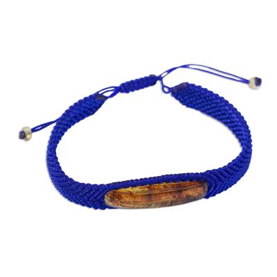 Amber pendant bracelet, 'Electrum in Blue' - Ultramarine Macrame Bracelet with Amber Pendant