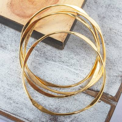 Gold plated stacking bangle bracelets, 'Gold Ribbon' (set of 7) - Gold Plated Stacking Bangle Bracelet Set (Set of 7)
