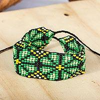 Beaded wristband bracelet, 'Peyote Flower in Green' - Green Floral Beaded Wristband Bracelet