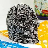 Beaded skull, 'Our Children' - Black and Grey Beaded Skull Figurine with Huichol Symbols