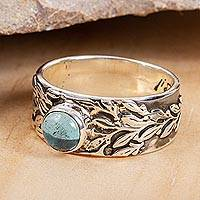 Blue topaz cocktail ring, 'Leaf Encounter' - Leaf Motif Blue Topaz Ring