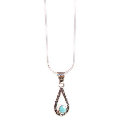 Turquoise pendant necklace, 'Luminous Rain' - Natural Turquoise Handcrafted Textured Taxco Silver Necklace