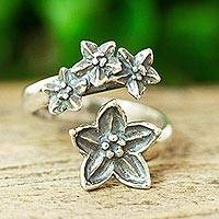 Sterling silver wrap ring, 'Flower Reunion' - Floral Sterling Wrap Ring