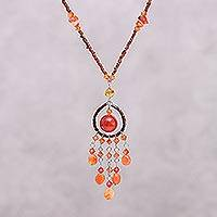 Carnelian pendant necklace, 'Orange Dreamcatcher' - Artisan Crafted Carnelian Necklace