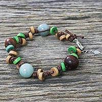 Jade beaded bracelet, 'Nature's Embrace' - Handcrafted Mango Wood and Jade Bracelet