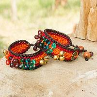 Beaded wristband bracelets, 'Bold Orange Fortunes' (pair)