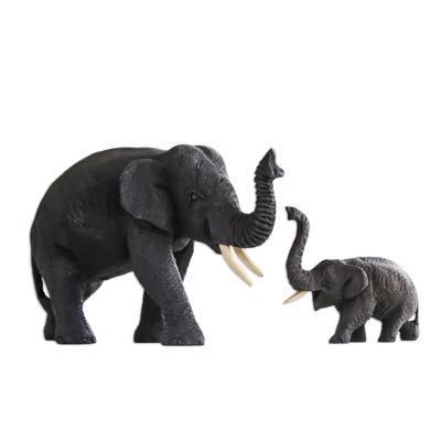 Teak sculptures (Pair)