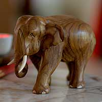 Teak sculpture, 'Purposeful Elephant'
