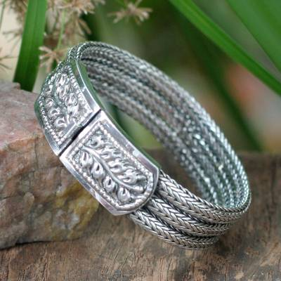 Sterling silver wristband bracelet, 'Braided Hideaway' - Handcrafted Floral Sterling Silver Bracelet