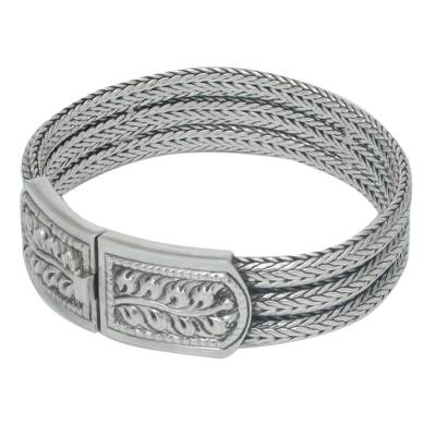 Sterling silver wristband bracelet, 'Braided Hideaway' - Handcrafted Floral Sterling Silver Bracelet