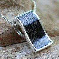 Coconut shell pendant necklace, 'Rollercoaster' - Coconut shell pendant necklace