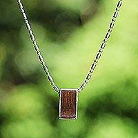 Coconut shell pendant necklace, 'Slide' - Handcrafted Coconut Shell Pendant Necklace