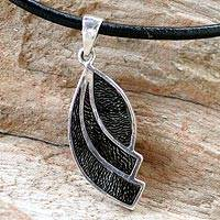 Coconut shell pendant necklace, 'Black Seashell' - Coconut shell pendant necklace