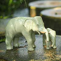 Celadon ceramic statuettes, 'Elephant Dad with Junior' (pair)