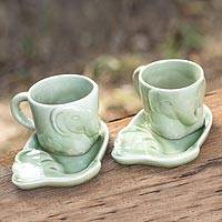 Celadon ceramic coffee mug set, 'Elephant Tales' (pair) - Hand Made Pair of Ceramic Cups With Saucers