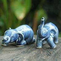Celadon ceramic figurines, 'Playful Blue Elephants' (pair) - A Pair of Blue Ceramic Elephant Figurines
