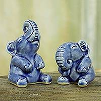 Celadon ceramic statuettes, 'Happy Blue Elephants' (pair) - Pair of Celadon Ceramic Elephant Sculptures