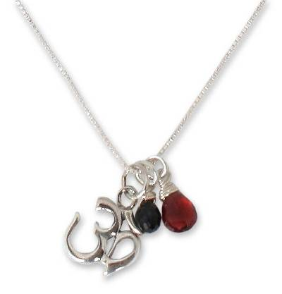 Garnet and onyx flower necklace, 'Spirit Voice' - Hand Made Sterling Silver and Onyx Pendant Necklace