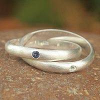 Iolite and topaz solitaire rings, 'Creation' (pair) - Fair Trade Sterling Silver and Iolite Ring