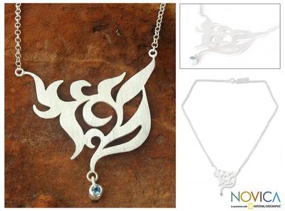 Blue topaz floral necklace, 'Blue Dew' - Sterling Silver and Blue Topaz Pendant Necklace