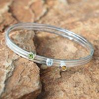 Blue topaz and citrine bangle bracelets, 'Spring Rainbow' (set of 3) - Silver Blue Topaz and Peridot Bangle Bracelets (Set of 3)