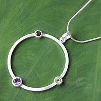 Garnet and amethyst pendant necklace, 'Spring Color' - Amethyst and Garnet Silver Pendant Necklace