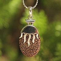 Coconut shell pendant necklace, 'Anemone' - Coconut shell pendant necklace