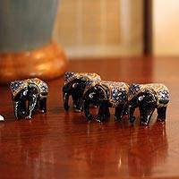 Lacquered wood figurines, 'Four Young Elephants' (set of 4) - Unique Thai Animal Themed Rain Tree Wood Sculptures