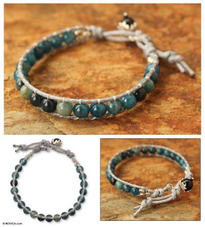 Apatite and agate beaded bracelet, 'Sea Light Serenade' - Handcrafted Kyanite and Agate Beaded Bracelet